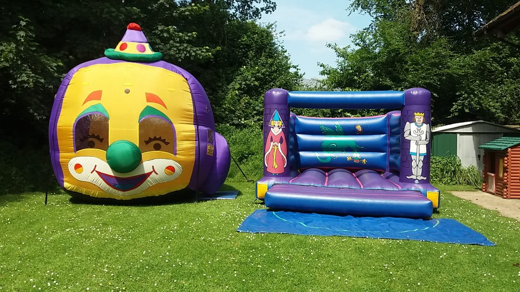 Knights Bouncy Castle and Clown Balloon Typhoon Hire in Lyndhurst, Special Price for 2nd Birthday Party