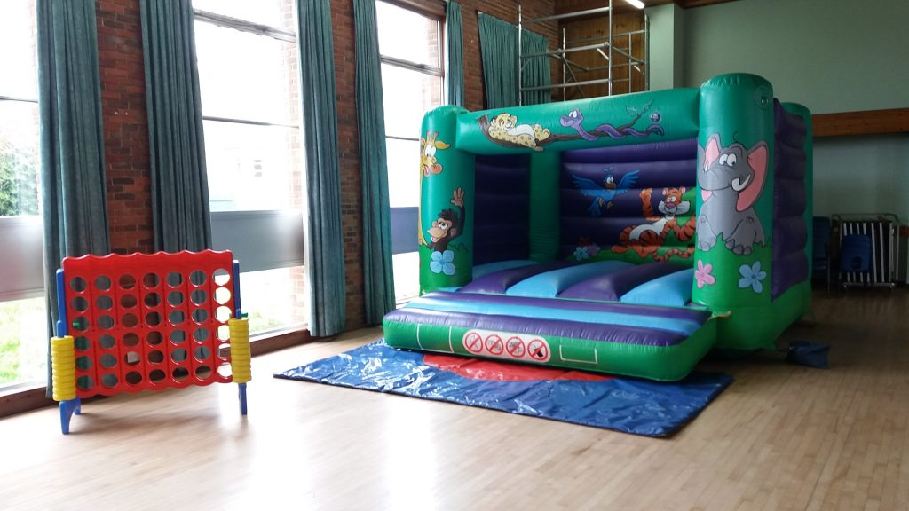 Jungle bouncy castle hire with giant connect four game on hire at Peartree Church Hall