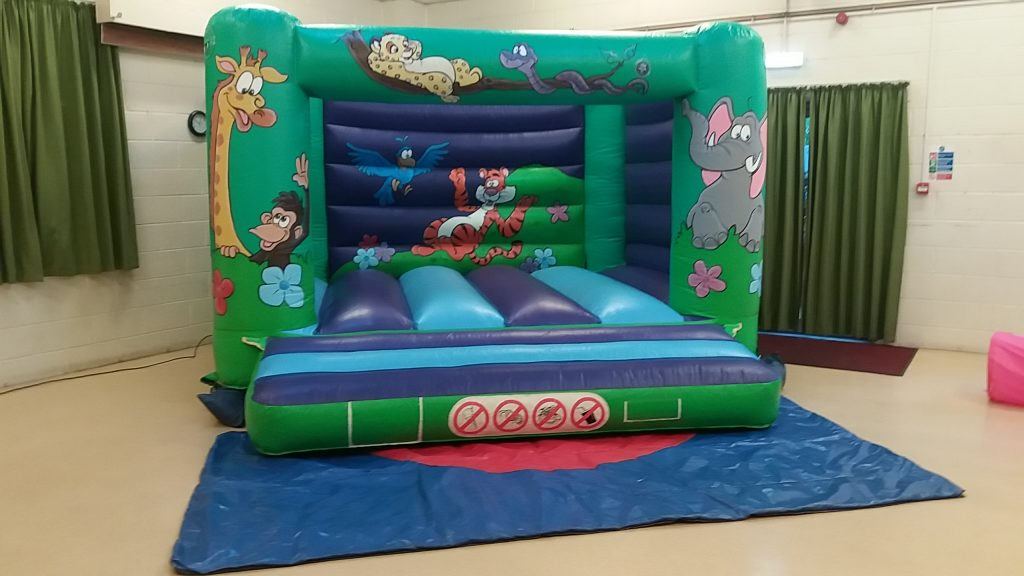 Jungle bouncy castle hire for children birthday party christening