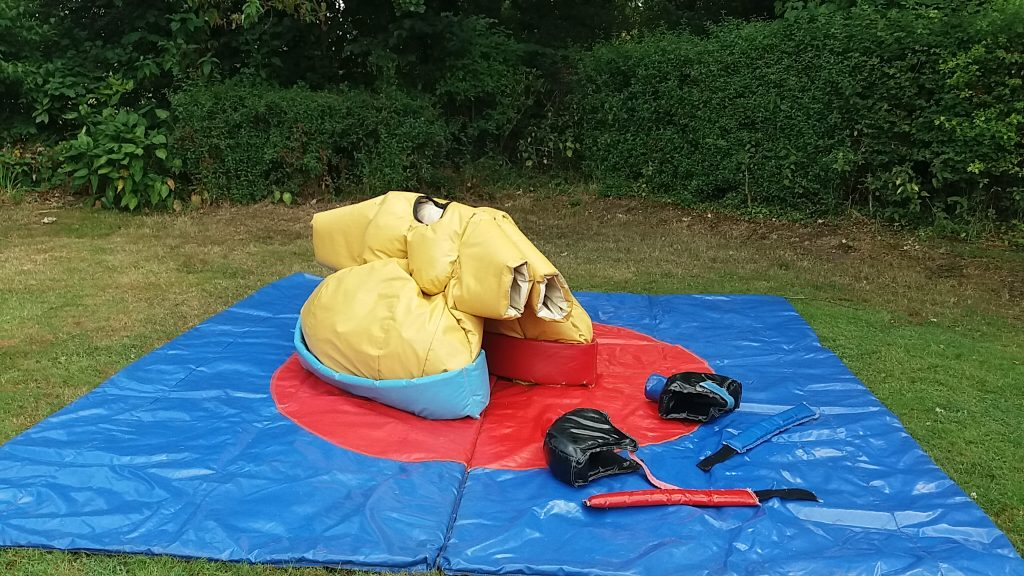 sumu fat wrestling suit hire with safety mat for family parties