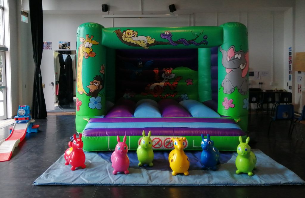 Jungle Bouncy Castle with animal hoppers and Thomas the Tank Roller Coaster for pre school party at Tauntons College