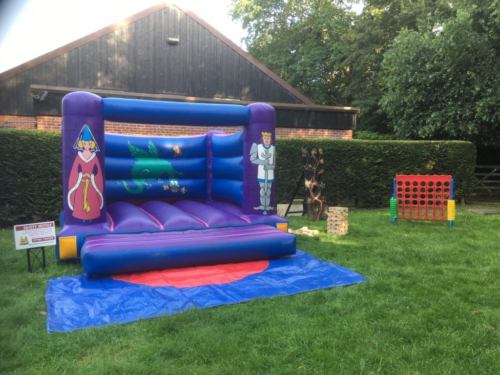 Bouncy castle with giant garden games wedding reception hire